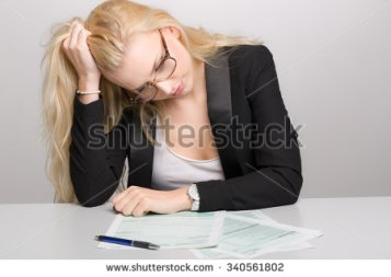 stock-photo-young-business-woman-in-stress-with-tax-forms-340561802.jpg